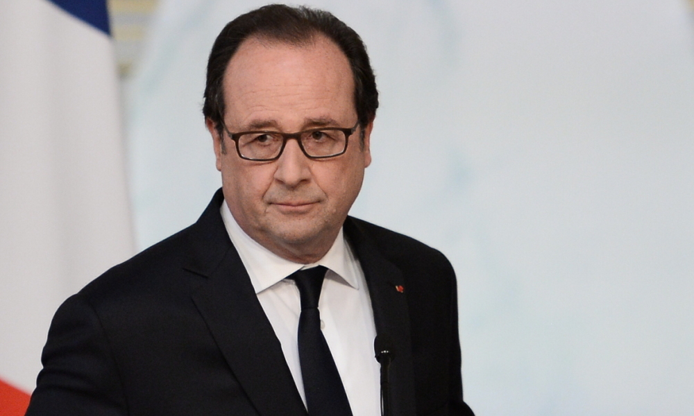 French President Francois Hollande makes a statement at the Elysee Presidential Palace in Paris on July 22, 2016, after holding a meeting with security officials during the fourth defence council since the Bastille Day attacks in Nice.  STEPHANE DE SAKUTIN / AFP