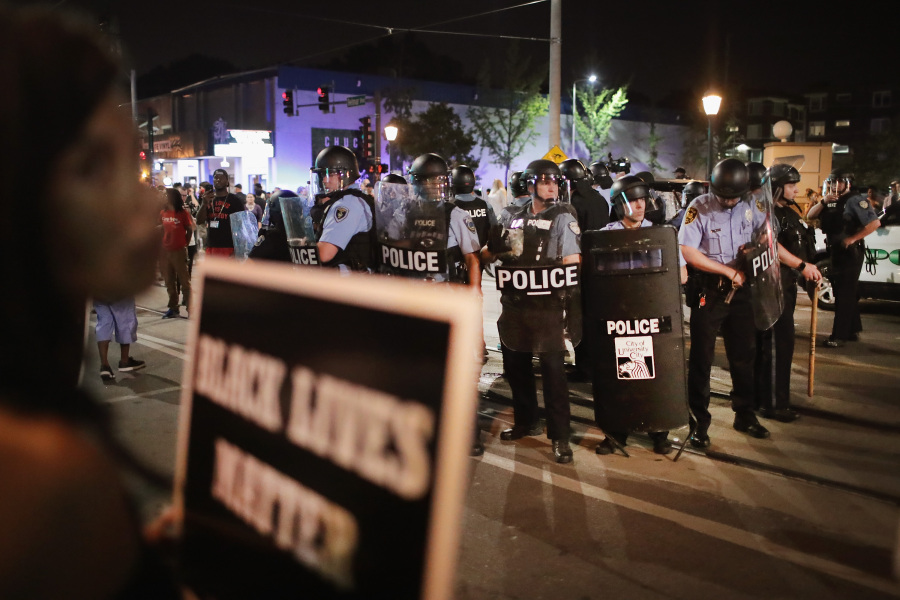 ST LOUIS, MO - SEPTEMBER 16: Demonstrators confront police while protesting the acquittal of former St. Louis police officer Jason Stockley on September 16, 2017 in St. Louis, Missouri.