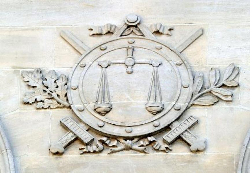 A picture taken on August 17, 2012 shows a high relief on the facade of the Amiens criminal court prior to the hearing of the three young men arrested in connection with rioting that devastated part of the northern city of Amiens earlier...
