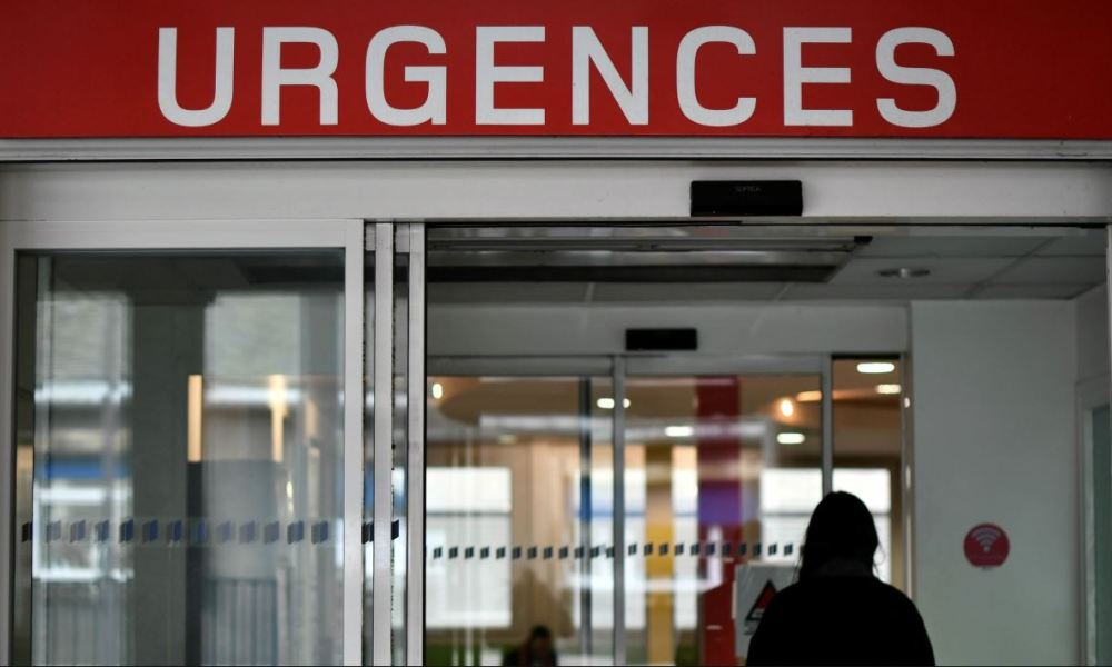 A woman arrives at the emergency department of the Cochin Hospital in Paris on January 11, 2017. French hospitals are being stretched to their limits by a major flu epidemic sweeping the country, France's health authorities warn.