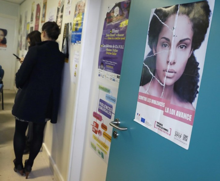 "A poster reading ""Towards violences, the law improves"" is pictured at the French Fédération Nationale Solidarité Femmes (National Federation for women's solidarity) on November 25, 2016 in Paris, on the International Day for the Elimination of Violence against Women.  PATRICK KOVARIK / AFP"