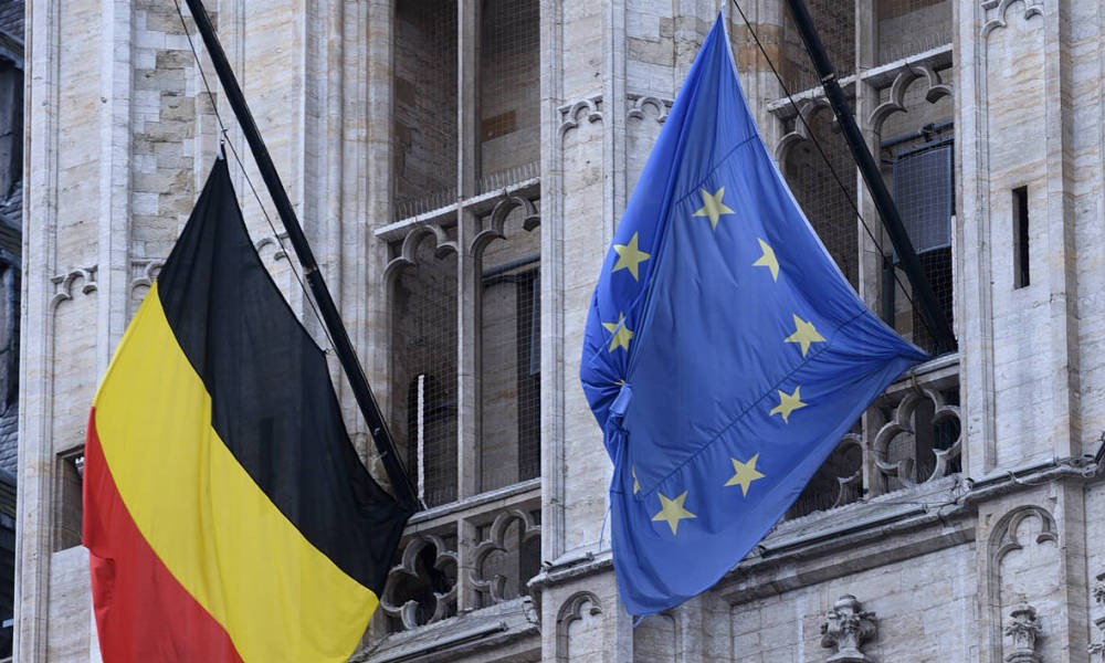 A Belgian and a European flag fly at half-mast in Brussels on March 23, 2016, a day after blasts hit the Belgian capital. World leaders united in condemning the carnage in Brussels and vowed to combat terrorism, after Islamic State bombers killed 31 people in a strike at the symbolic heart of the EU.