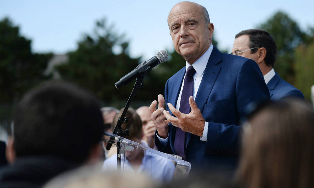 Mayor of Bordeaux and right-wing primary elections candidate Alain Juppe (C) delivers a speech during a Summer University meeting of the local Loire-Atlantique department of the Republican group on September 5, 2015 in La Baule, western France. AFP PHOTO / JEAN-SEBASTIEN EVRARD