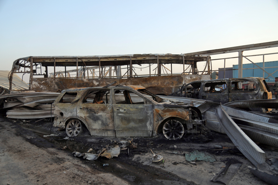 A general view shows the damage after gunmen and suicide car bombers killed dozens of people in two assaults claimed by Islamic State (IS) group jihadists near the southern Iraqi city of Nasiriyah on September 14, 2017. The attackers struck at midday, opening fire on a restaurant before getting into a car and blowing themselves up at a nearby security checkpoint, officials said. Haidar HAMDANI / AFP