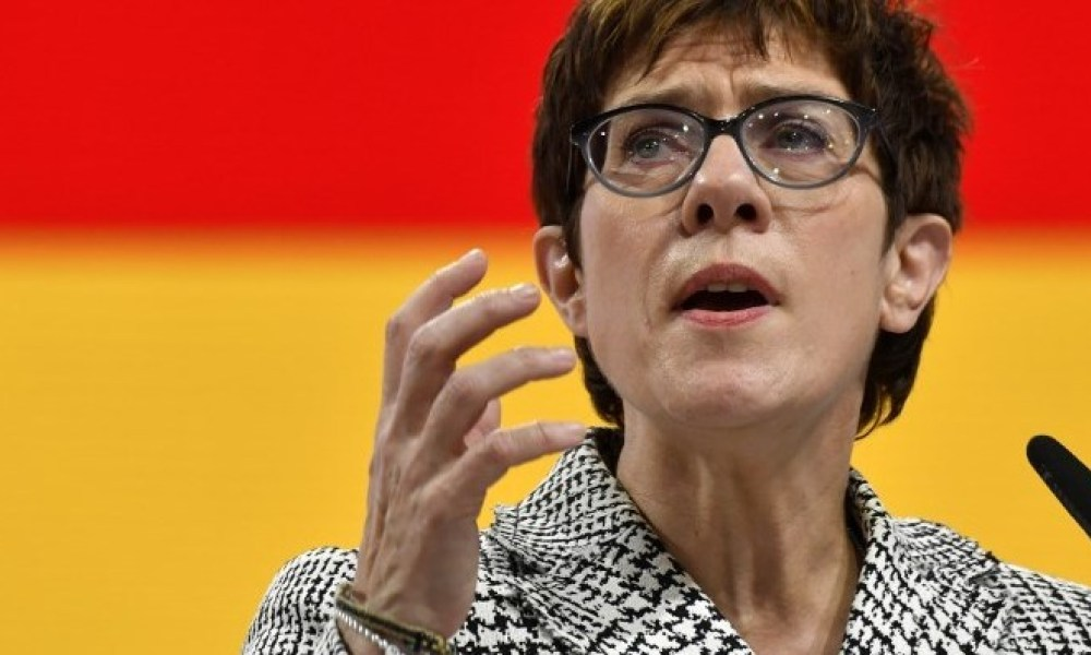 The Secretary General of the Christian Democratic Union (CDU) and candidate for the party's leadership Annegret Kramp-Karrenbauer gives a speech during a party congress to determine German chancellor's successor on December 7, 2018 at a fair hall in Hamburg, northern Germany. German Chancellor Angela Merkel will hand off leadership of her party after nearly two decades at the helm, with the race wide open between a loyal deputy and a longtime rival. John MACDOUGALL / AFP