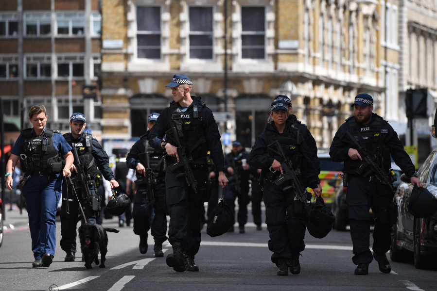 Armed Police officers patrol on Borough High Street in London on June 4, 2017, as police continue their investigations following the June 3 terror attack. Seven people were killed in a terror attack on Saturday by three assailants on London Bridge and in the bustling Borough Market nightlife district, the chief of London's police force said on Sunday. Chris J Ratcliffe / AFP