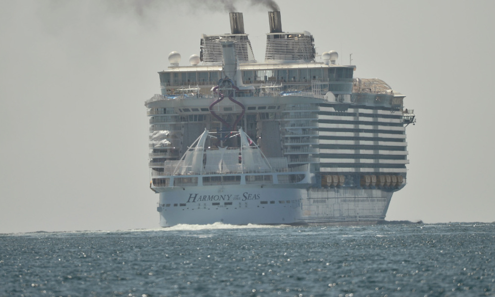 A photo taken on May 15, 2016 shows the Harmony of the Seas cruise ship as it sails from the STX Saint-Nazaire shipyard, western France, out to sea. The world's biggest-ever cruise ship, the 120,000-tonne Harmony of the Seas, a luxury home on the waves for 8,500 passengers and crew, was handed over by a French shipyard after a 40-month engineering feat. At 66 metres (217 feet), it is the widest cruise ship ever built, while its 362-metre length makes it 50 metres longer than the height of the Eiffel Tower. The floating town, which cost close to one billion euros, has 16 decks and will be able to carry 6,360 passengers and 2,100 crew members.  JEAN-FRANCOIS MONIER / AFP