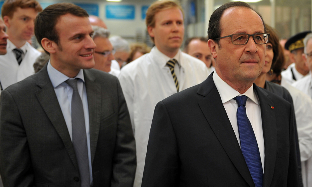 French Economy Minister Emmanuel Macron, French President Francois Hollande and Novo Nordisk CEO Lars Rebien Sorensen visit the insulin production plant of Danish multinational pharmaceutical company Novo Nordisk in Chartres, north-central France, on April 21, 2016.