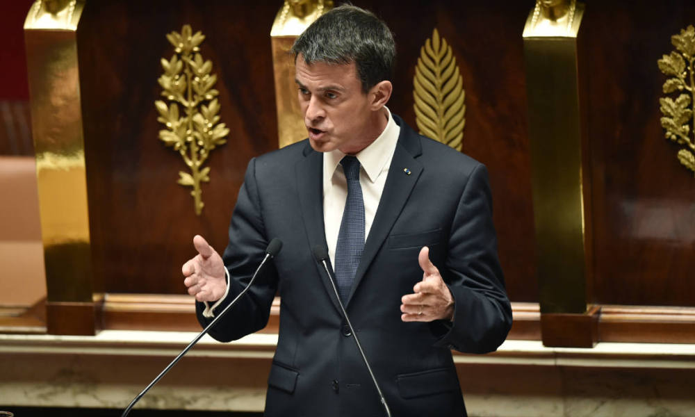 French Prime Minister Manuel Valls announces the use of the constitution's controversial Article 49.3, allowing the government to bypass parliament to ram through a labour reform bill at the National Assembly in Paris on May 10, 2016. The proposed labour reform, which would make it easier for employers to hire and fire workers, has sparked waves of sometimes violent protests across France since early March.