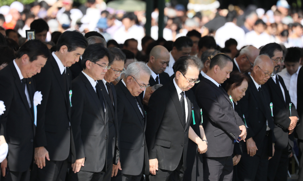 Attendants offer a minute of silence during the 72nd anniversary memorial service for the atomic bomb victims at the Peace Memorial Park in Hiroshima on August 6, 2017. A US B-29 plane dropped a bomb over the city at 8:15am on August 6, 1945, marking the first use of an atomic weapon which ultimately claimed the lives of some 140,000 people. STR / JIJI PRESS / AFP