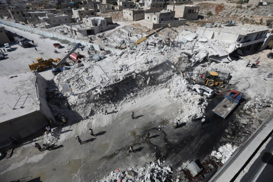 Destroyed buildings are seen on August 12, 2018 following an explosion at an arms depot in a residential area in Syria's northern Idlib province city of Sarmada in which 12 people were reportedly killed.  OMAR HAJ KADOUR / AFP