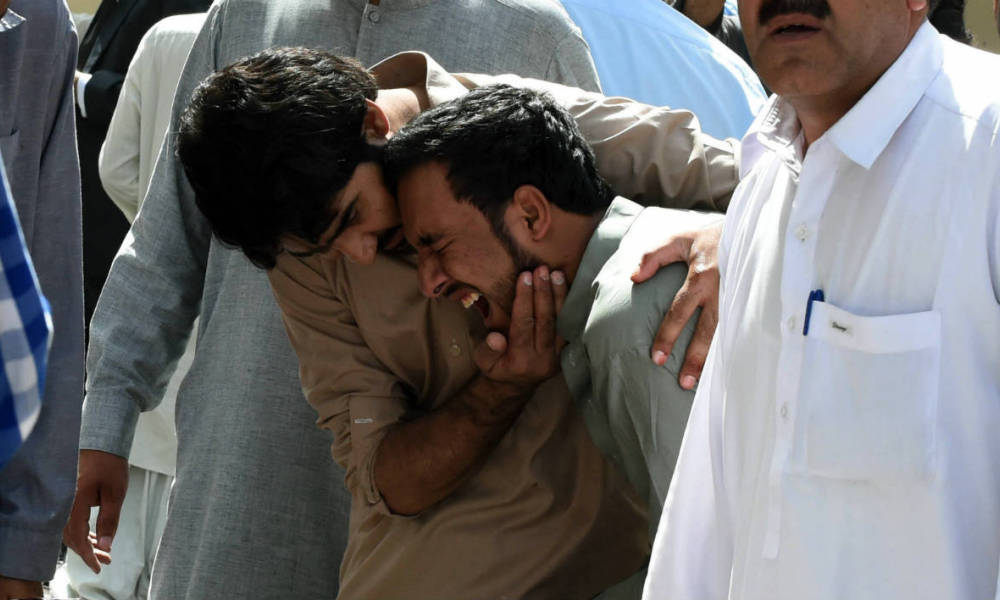Pakistani local journalists react over the body of a news cameraman after a bomb explosion at a government hospital premises in Quetta on August 8, 2016. At least 35 people were killed and dozens more wounded after a blast at a major hospital in the Pakistani city of Quetta, an AFP reporter and officials said, with fears the toll could rise.