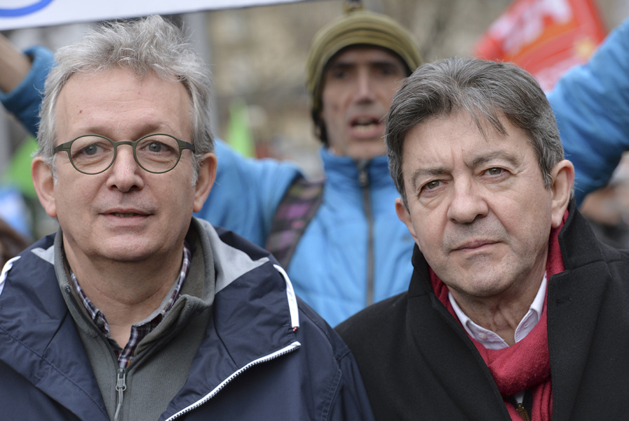 French Communist Party (PCF) national secretary Pierre Laurent (L) and leftist Front de Gauche (FG) leader Jean-Luc Melenchon (R) attend a demonstration in support of the Greek people on February 15, 2015 in Paris. At least 2,000 people marched through the streets of Paris on February 15 heeding the call from unions and far-left organisations to voice their support for Greece and its new leftist anti-austerity government.