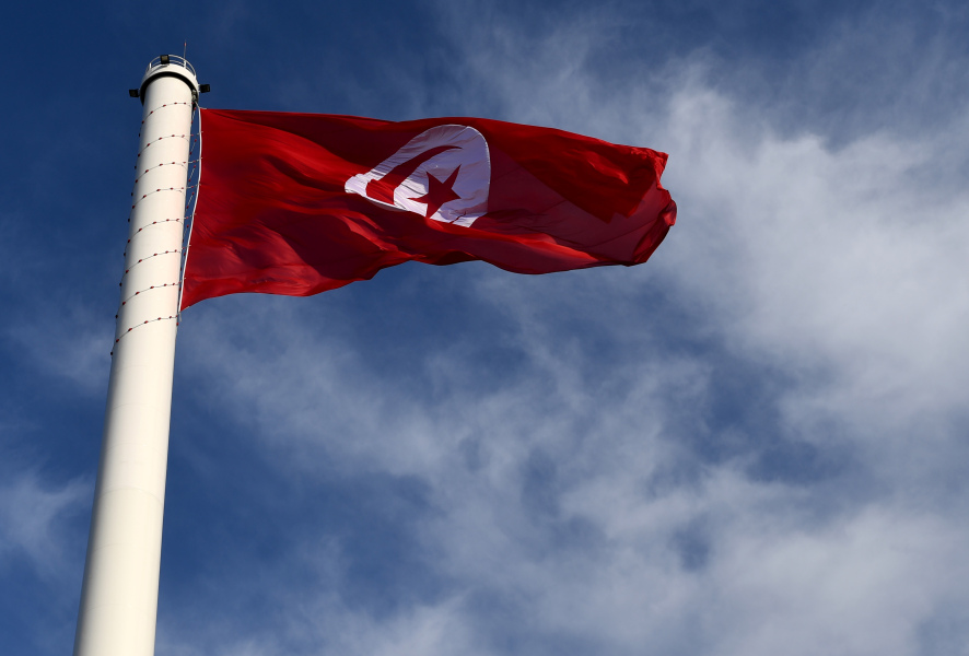 The Tunisian flag sways in the wind on March 20, 2017, following it's inauguration by Tunisia's Prime Minister during an official ceremony that was preceded by a controversy over the importation of the fabric used to make the flag from Turkey.  FETHI BELAID / AFP