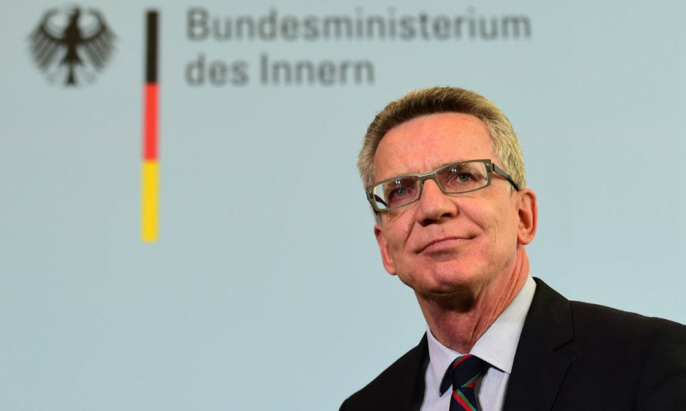 "German Interior Minister Thomas de Maiziere delivers a statement on a forecast on the number of asylum seekers expected to arrive in Europe's biggest economy this year in Berlin, on August 20, 2015. Germany is expecting to receive ""up to 800,000"" asylum seekers in 2015, a record figure, said de Maiziere. AFP PHOTO / JOHN MACDOUGALL"