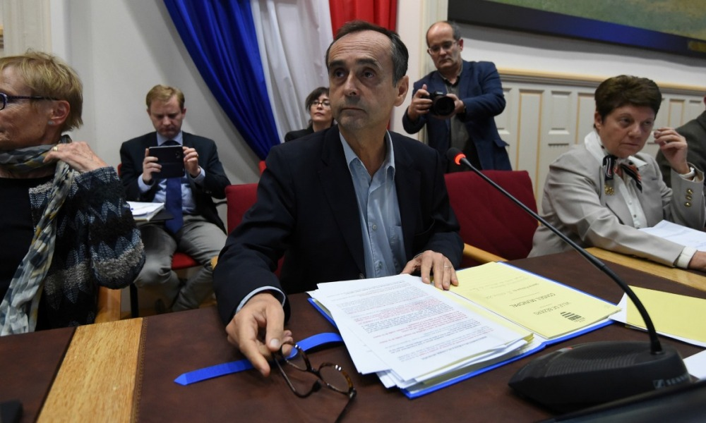 Beziers' mayor Robert Menard (C) leads a municipal council in Beziers, southern France, on October 18, 2016, during which a local referendum on the welcoming of migrants to the city was planned to take place at the end of the meeting.