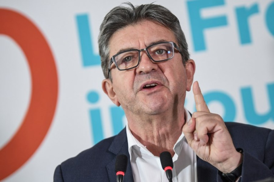 "Jean-Luc Melenchon, leader of the far-left party France Insoumise (France Unbowed), speaks during a press conference on October 19, 2018 in Paris, a day after he was heard by a judge and three days after French police raided his party's headquarters after prosecutors opened an inquiry into suspected campaign financing violations and ""fake jobs"" for EU parliament assistants.  Eric FEFERBERG / AFP"