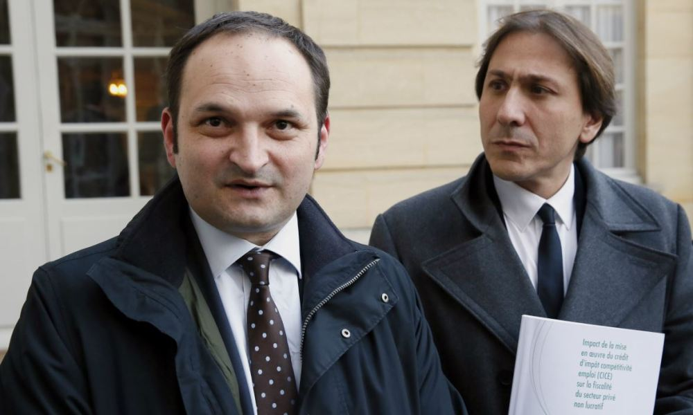 Socialist members of Parliament Regis Juanico (L) and Jerome Guedj leave the Hotel Matignon in Paris after presenting a report focused on the impact of the implementation of tax credit for employment and competitiveness (CICE) on the non profit private sector to French Prime minister, on December 12, 2013. AFP PHOTO/ PATRICK KOVARIK PATRICK KOVARIK / AFP