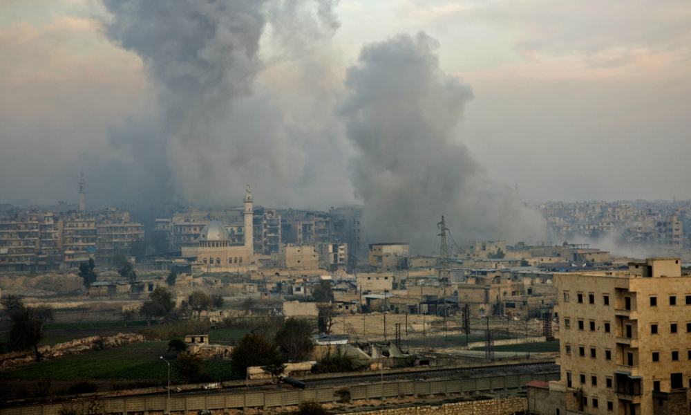 "Smoke billows from the former rebel-held district of Bustan al-Qasr in Aleppo, on December 12, 2016, during an operation by Syrian government forces to retake the embattled city. The crucial battle for Aleppo entered its ""final phase"" after Syrian rebels retreated into a small pocket of their former bastion in the face of new army advances. The retreat leaves opposition fighters confined to just a handful of neighbourhoods in southeast Aleppo, the largest of them Sukkari and Mashhad."