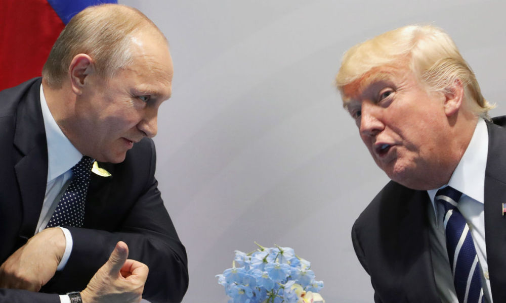 US President Donald Trump (R) and Russia's President Vladimir Putin speaks during their meeting on the sidelines of the G20 Summit in Hamburg, Germany, on July 7, 2017. Leaders of the world's top economies will gather from July 7 to 8, 2017 in Germany for likely the stormiest G20 summit in years, with disagreements ranging from wars to climate change and global trade. Mikhail KLIMENTIEV / SPUTNIK / AFP
