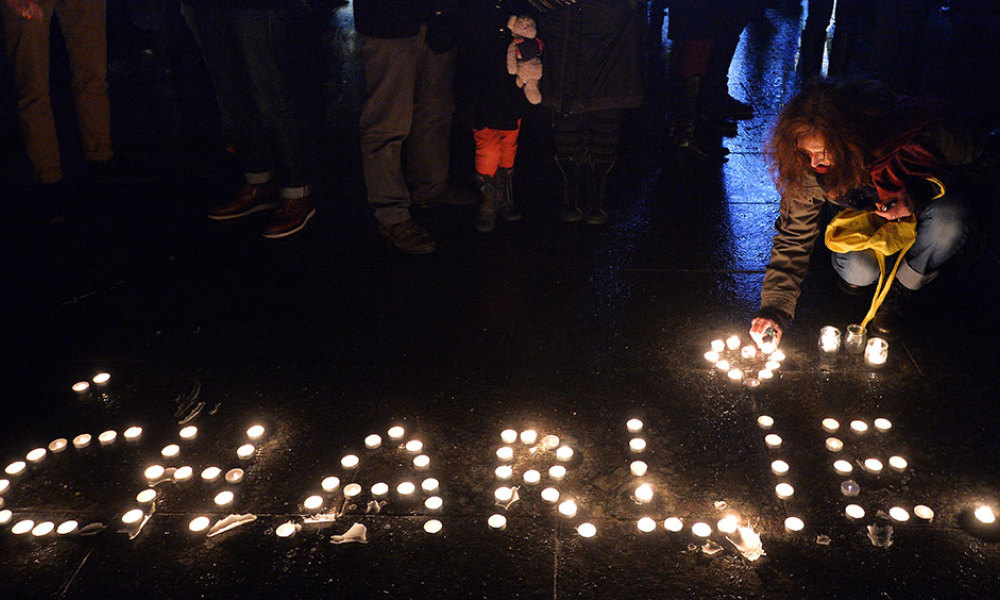 This file photo taken on January 07, 2015 shows people lighting candles forming the name Charlie during a gathering in Strasbourg, eastern France, following an attack by unknown gunmen on the offices of the satirical weekly Charlie Hebdo. The attacks of January 7 to 9, 2015, which started with the massacre of Charlie Hebdo and ended with the assault against the Hyper Cacher market in Paris, have moved France into a new era, as the country faces the threat of jihadists and tensions within society.