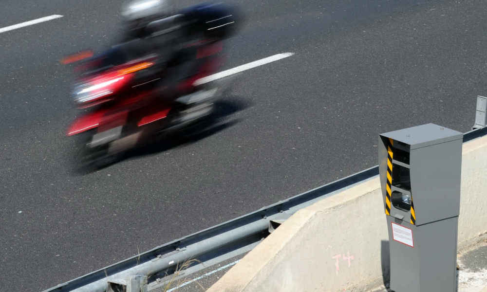 A picture taken on April 3, 2013 in Saint-Aunes-Odysseum shows a moto driven in front of a radar on the A9 motorway. AFP PHOTO / PASCAL GUYOT