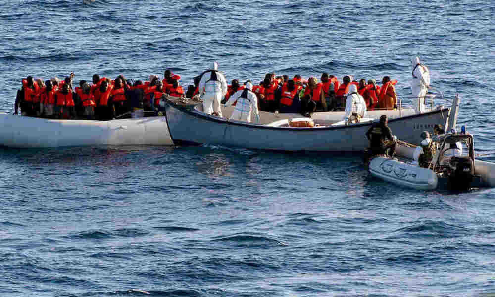 This handout picture taken on January 27, 2016 and released by the Marina Militare (Italian Navy) on January 28, 2016 shows crew members of the Italian navy ship Aliseo taking part in an operation in which 290 migrants were rescued from three dinghies off the Libyan coast, in the Mediterranean Sea. The Italian navy said on January 28, 2016 it had recovered six bodies from a sinking dinghy off Libya and pulled 290 migrants to safety as they attempted the perilous crossing to Europe. Over 2,500 people were rescued off the coast of Libya in the past week, bringing the number for January to almost 5,000, significantly more than the 3,528 people who were rescued in January last year. Handout / MARINA MILITARE / AFP