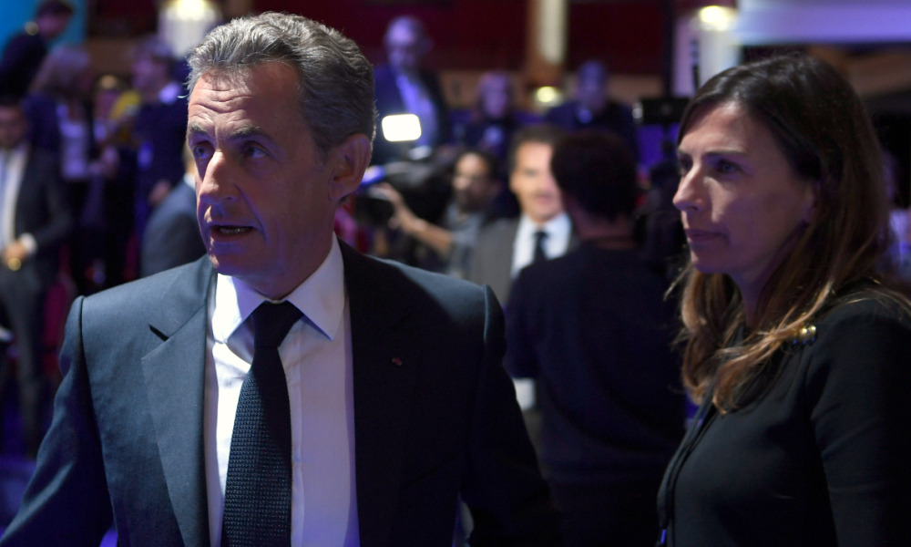 Former French President and candidate for the right-wing Les Republicains (LR) party primaries ahead of the 2017 presidential election, Nicolas Sarkozy (L) and his press advisor Veronique Wache leave the set after the second debate of the right-wing Les Republicains (LR) party primaries on November 3, 2016 at the salle Wagram venue in Paris.  Eric FEFERBERG / POOL / AFP
