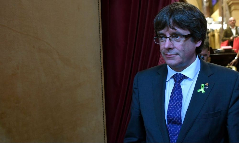 Catalan president Carles Puigdemont leaves the hemicycle after Catalonia's parliament voted to declare independence from Spain on October 27, 2017 in Barcelona. Catalonia's parliament voted to declare independence from Spain and proclaim a republic, just as Madrid is poised to impose direct rule on the region to stop it in its tracks.