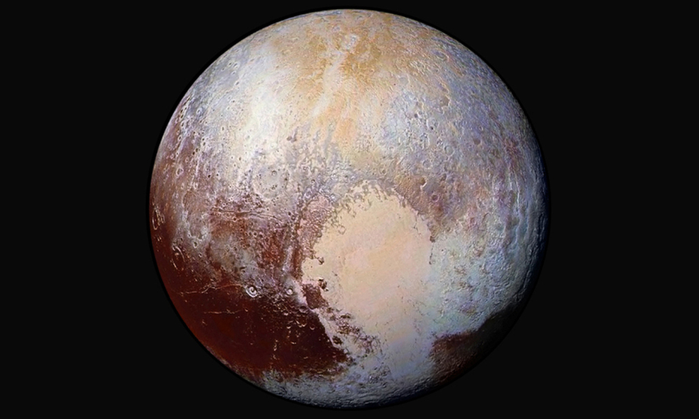 This NASA image obtained July 24, 2015 shows how New Horizons scientists have used enhanced color images to detect differences in the composition and texture of Pluto's surface.