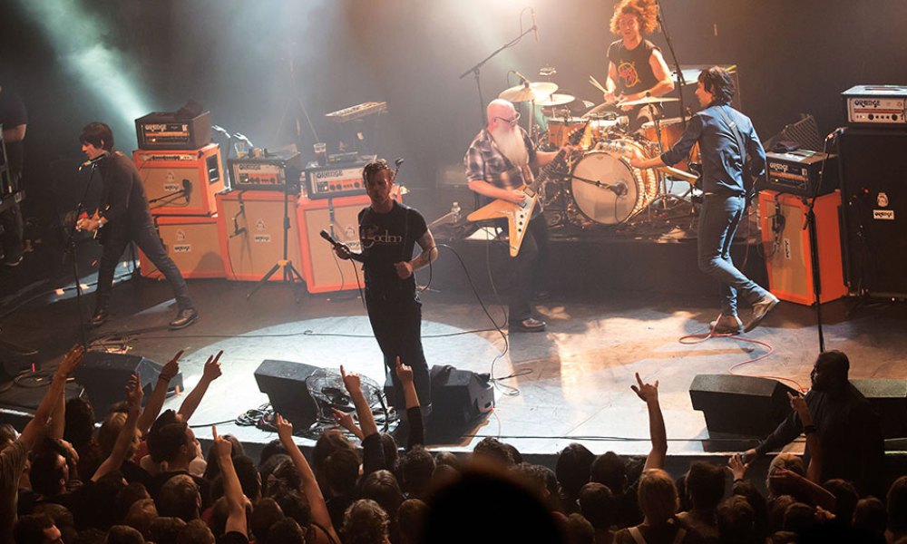 "American rock group Eagles of Death Metal perform on stage on November 13, 2015 at the Bataclan concert hall in Paris, few moments before four men armed with assault rifles and shouting ""Allahu akbar"" (""God is great!"") stormed into the venue. Islamic State jihadists on November 14, 2015 claimed a series of coordinated attacks by gunmen and suicide bombers in Paris that killed at least 128 people in scenes of carnage at the Bataclan, restaurants and the national stadium."