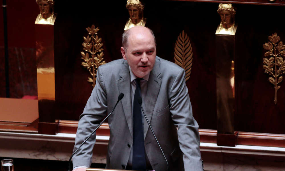 French Member of Parliament, Denis Baupin from Green party, speaks at the lectern during a debate on adaptation to European Union law in the field of sustainable development, on July 2, 2013 at the National Assembly in Paris. AFP PHOTO / JACQUES DEMARTHON JACQUES DEMARTHON / AFP
