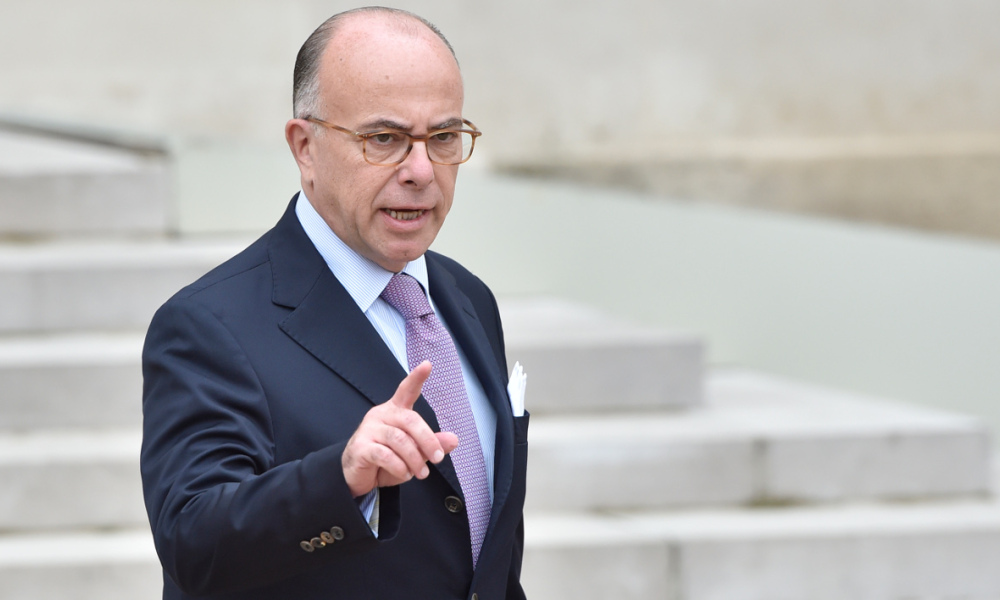 French Interior Minister Bernard Cazeneuve gestures as he leaves the weekly cabinet meeting at the Elysee Palace in Paris on October 19, 2016.  ALAIN JOCARD / AFP