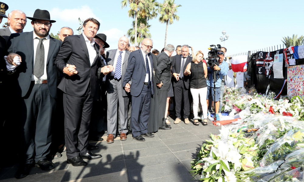 """President of the Provence Alpes Cote d'Azur region Christian Estrosi (2nd-L), officials and religious leaders attend a wreath-laying as a tribute to the victims of the Nice truck attack in Nice on July 21, 2016. Tunisian truck killer Mohamed Lahouaiej Bouhlel was helped to prepare his Bastille Day attack by five suspects who are now in custody, a prosecutor said on July 21, 2016. Francois Molins said the four men and a women were """"involved in the preparation"""" of the attack in the French Riviera resort of Nice, which had been planned months in advance.  VALERY HACHE / AFP"""