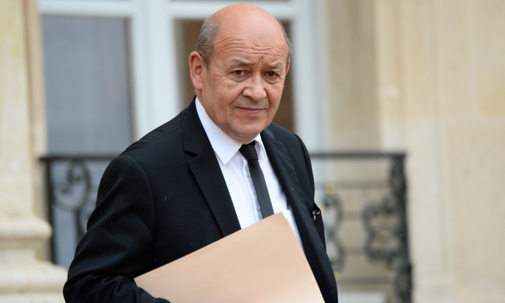 French Defense minister Jean-Yves Le Drian leaves after an extraordinary cabinet meeting, on May 10, 2016 at the Elysee palace in Paris. The meeting is held to allow the presidency to force through a highly contested labour reform without a parliamentary vote. The proposed reform, which would make it easier for employers to hire and fire workers, has sparked waves of sometimes violent protests across France since early March. AFP PHOTO / BERTRAND GUAY 