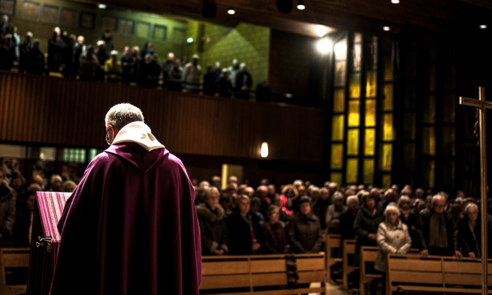Father Eric De Nattes leads a mass on November 7, 2016 in Sainte Foy les Lyon Saint Luc church, to pay to tribute to the victims who have been sexually abused by father Preynat. On November 7, 2016 in Sainte Foy les Lyon Saint Luc church, a mass was held to pay tribute to the victims who have been sexually abused by Father Preynat, suspect of having abused 70 scouts while in service. JEFF PACHOUD / AFP