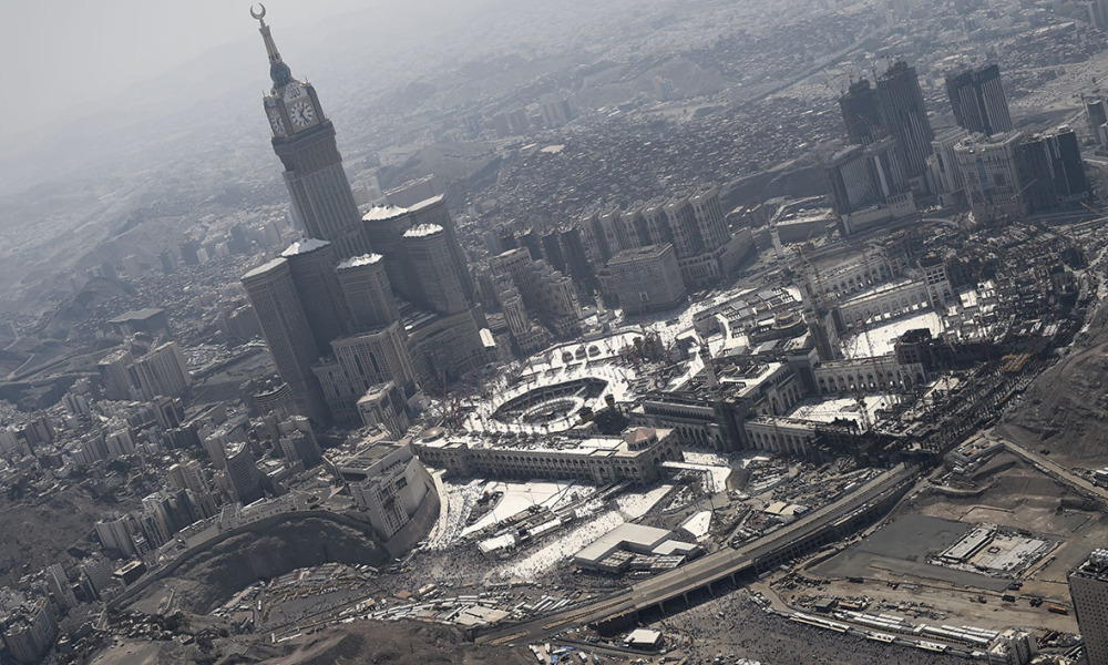 An aerial view shows the Clock Tower and the Grand Mosque in Saudi Arabia's holy Muslim city of Mecca on September 25, 2015. At least 700 people were killed and hundreds wounded during a stampede at the annual hajj in Saudi Arabia, in the second tragedy to strike the pilgrims this year