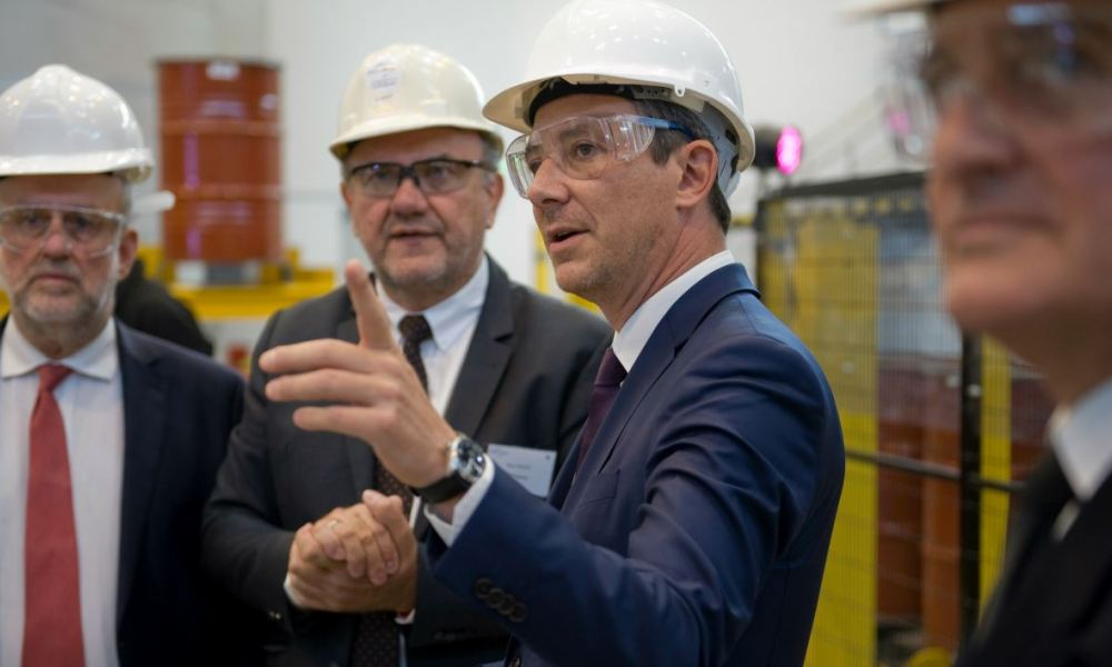 "French Junior Minister for Economy Benjamin Griveaux (C) gestures as he attends the inauguration of French mining and metallurgy group Eramet ""EcoTitanium"" titanium alloys production plant using recycling technics, on September 15, 2017, in Saint-Georges-de-Mons, central France.  Thierry Zoccolan / AFP"