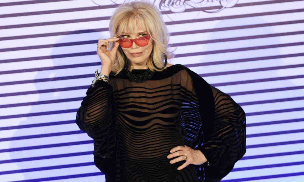 French singer Amanda Lear poses as she arrives to attend a party to celebrate the French fashion designer Jean-Paul Gaultier exhibition at the Grand Palais in Paris on March 31, 2015. AFP PHOTO / LOIC VENANCE