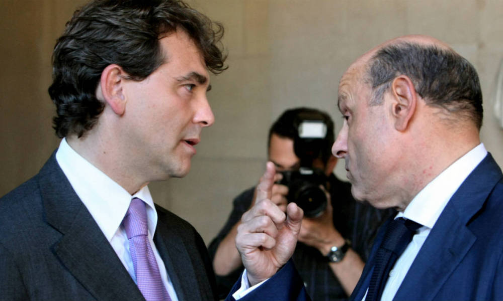 "Socialist deputy Arnaud Montebourg (L) chats with socialist Jean-Marie Le Guen after French deputies and senators voted during a special congress of both houses of parliament on Nicolas Sarkozy's plans to rewrite the constitution, on July 21, 2008 in Versailles. French lawmakers narrowly voted through Nicolas Sarkozy's plans to rewrite the constitution which the president says will make France more democratic but which the opposition fears will turn it into a ""monocracy."" The deputies and senators meeting in a special congress in the chateau of Versailles voted 539 for and 357 against, meaning that the bill scraped through by just one vote as a three-fifths majority was needed. AFP PHOTO THOMAS COEX THOMAS COEX / AFP"