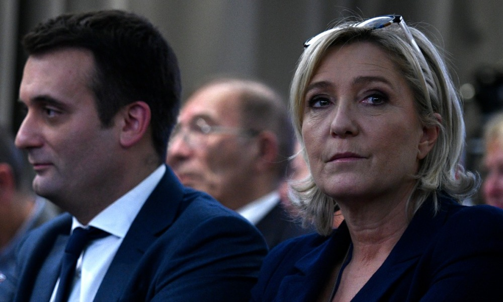 French far-right Front National (FN) party president, member of European Parliament and candidate for France's 2017 presidential election, Marine Le Pen (R) and FN vice-president Florian Philippot attend a meeting about healthcare, on December 9, 2016 in Paris.  MARTIN BUREAU / AFP