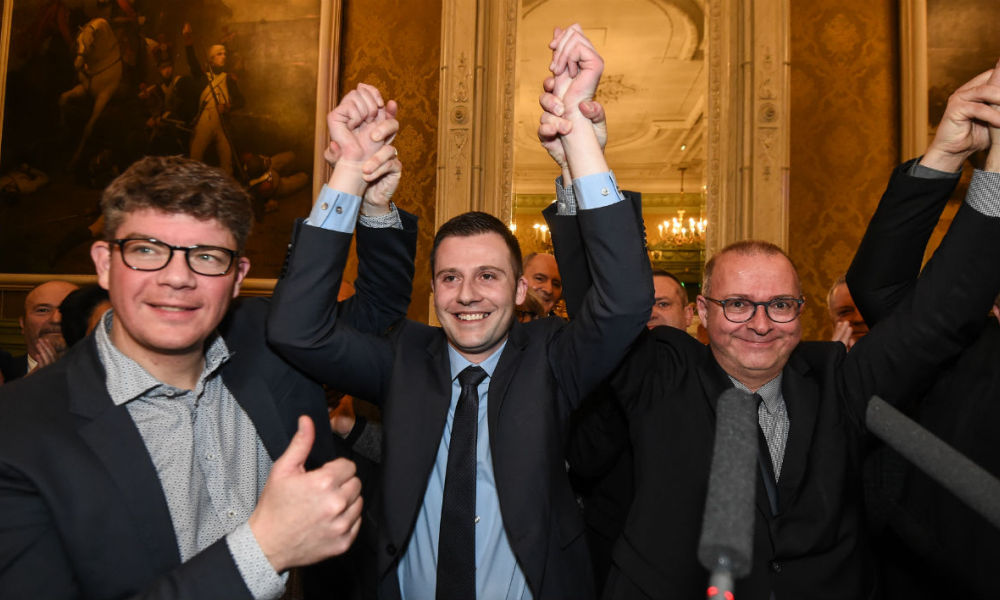 French right-wing Les Republicains (LR) party candidate Ian Boucard (C) celebrates flanked by LR senator Cedric Perrin (L) and Mayor of Belfort Damien Meslot (R) at the end of the second round of the legislative by-election in the 1st constituency of the French Territoire de Belfort region on February 4, 2018, in Belfort, eastern France.  SEBASTIEN BOZON / AFP