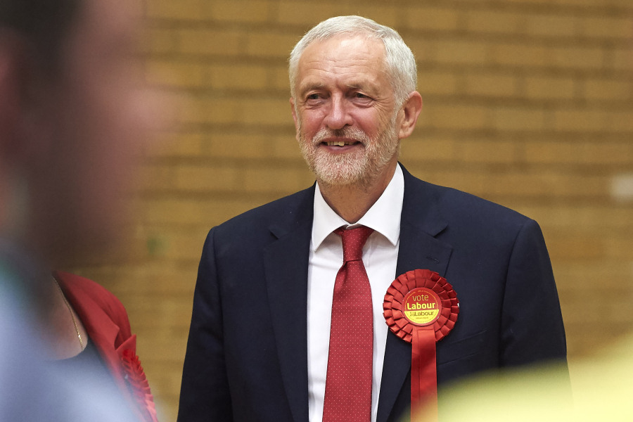 Labour party leader Jeremy Corbyn smiles as he arrives for the results to be declared at the count centre in Islington, London, early in the morning of June 9, 2017, hours after the polls closed in Britain's general election.  Niklas Hallen - AFP