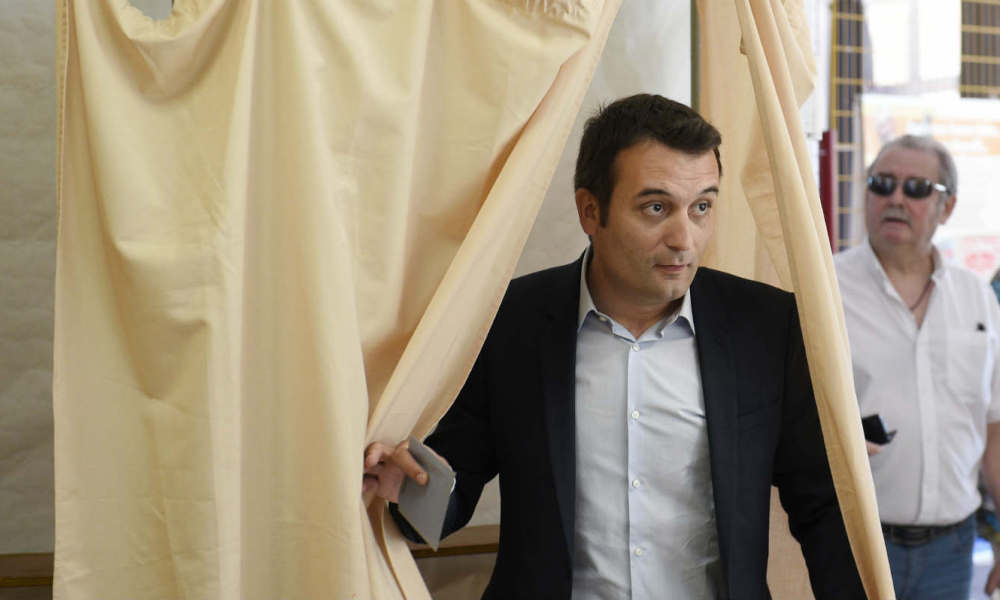 French far-right Front National (FN) party's vice-president and FN candidate for the legislative elections in the 6th district of the department of Moselle, Florian Philippot, walks out of the polling booth during the first round of the legislative elections at a polling station, on June,11 2017 in Forbach, eastern France.   JEAN CHRISTOPHE VERHAEGEN / AFP