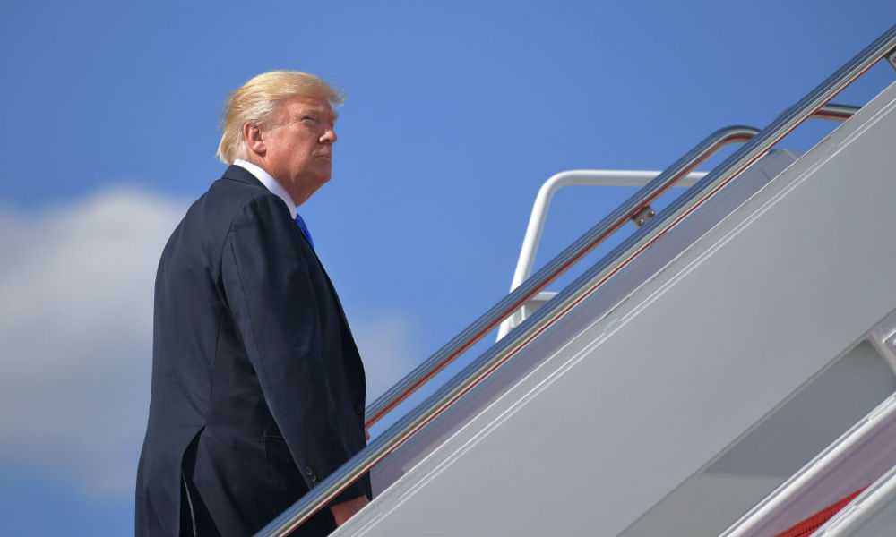 US President Donald Trump boards Air Force One before departing from Andrews Air Force Base in Maryland on June 9, 2017. Trump is heading to his Bedminister, New Jersey, golf club to spend the weekend. MANDEL NGAN / AFP