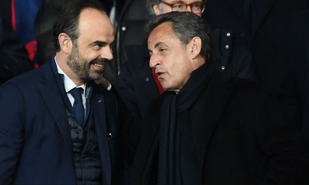 French former president Nicolas Sarkozy (R) and French Prime Minister Edouard Philippe attend the UEFA Champions League round of 16 second leg football match between Paris Saint-Germain (PSG) and Real Madrid on March 6, 2018, at the Parc des Princes stadium in Paris.  FRANCK FIFE / AFP