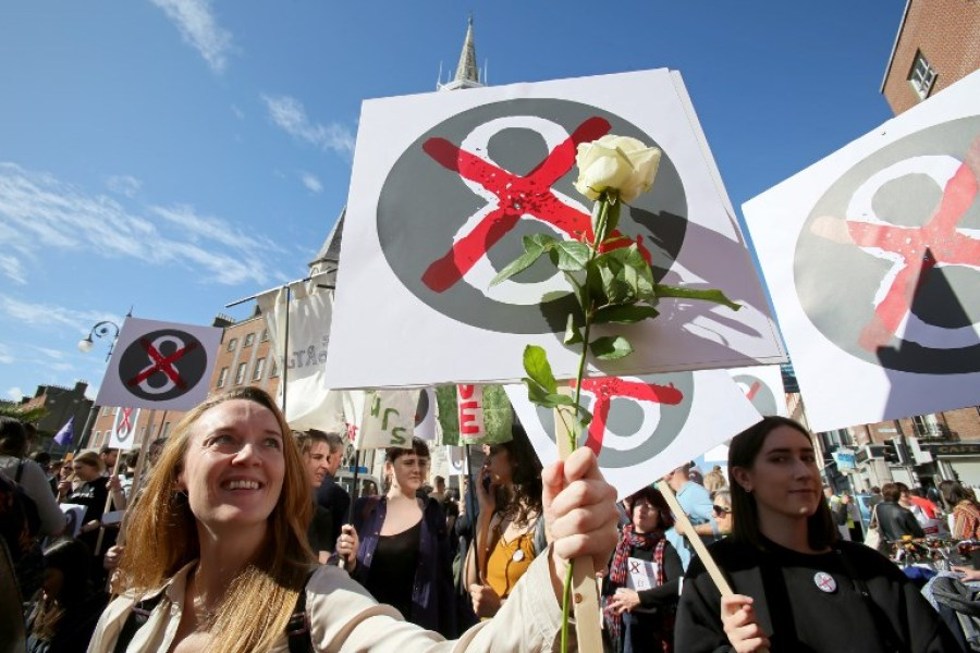 Protesters hold up placards as they take part in the March for Choice, calling for the legalising of abortion in Ireland after the referendum announcement, in Dublin on September 30, 2017. Tens of thousands are expected at a rally for abortion rights in Dublin on September 30, campaigning on one side of a fierce debate after Ireland announced it will hold a referendum on the issue next year. Paul FAITH / AFP