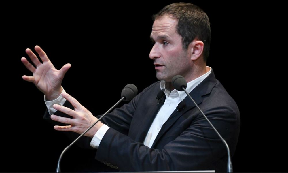 """Benoit Hamon, leader of the left-wing political movement """"First of July movement"""" (M1717), speaks after revealing the new name of his movement """"Generations"""" during the founding congress of his party, in Le Mans, northwestern France, on December 2, 2017.  JEAN-FRANCOIS MONIER / AFP"""
