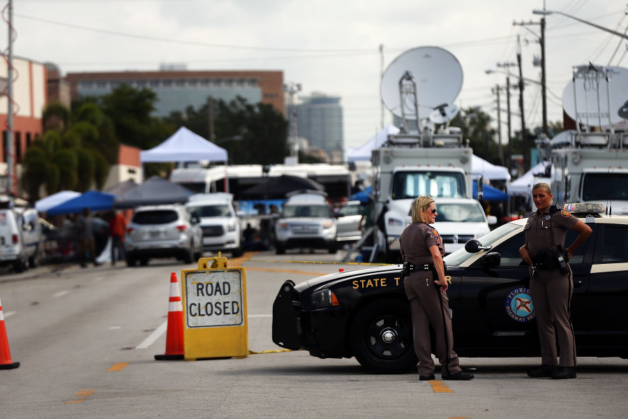 ORLANDO, FL - JUNE 17: Police stand guard down the road from the Pulse nightclub on June 17, 2016 in Orlando, Florida. Omar Mir Seddique Mateen killed 49 people and wounded 53 others at the popular gay nightclub early Sunday.
