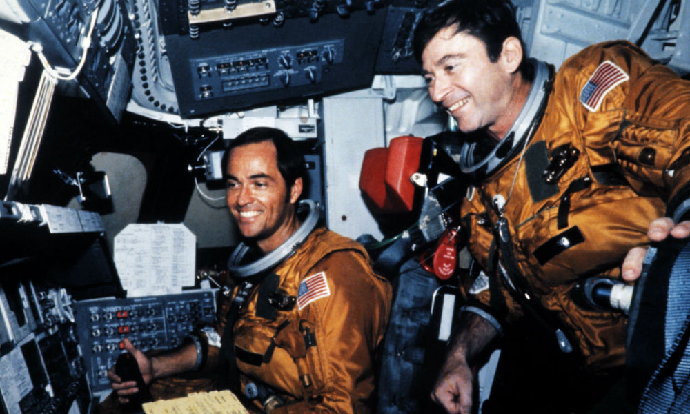 This file photo taken on April 11, 1981 shows  US Astronauts Robert Crippen (L) and John Young (R) in the flight deck of Columbia of the space shuttle Columbia before the first shuttle flight at Kennedy Space Center in Florida on April 12, 1981.